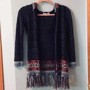 Colorful girls cardigan with pretty details.